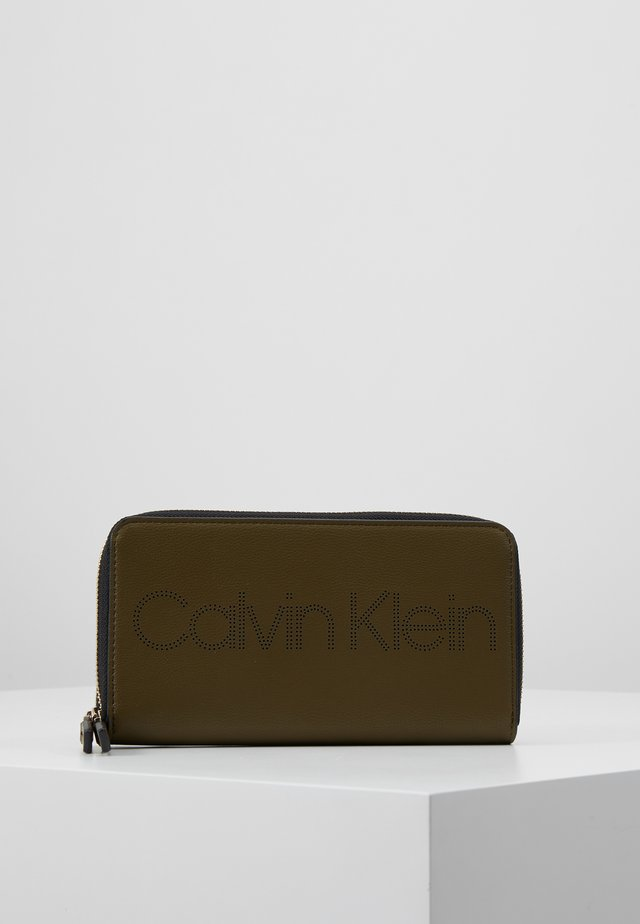 PUNCHED ZIPAROUND - Wallet - green