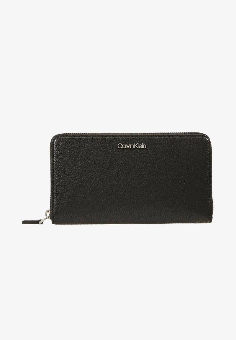 Calvin Klein - NEAT ZIPAROUND WALLET XL - Portafoglio - black