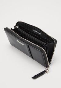 Calvin Klein - CHAIN ZIPAROUND - Wallet - black - 4