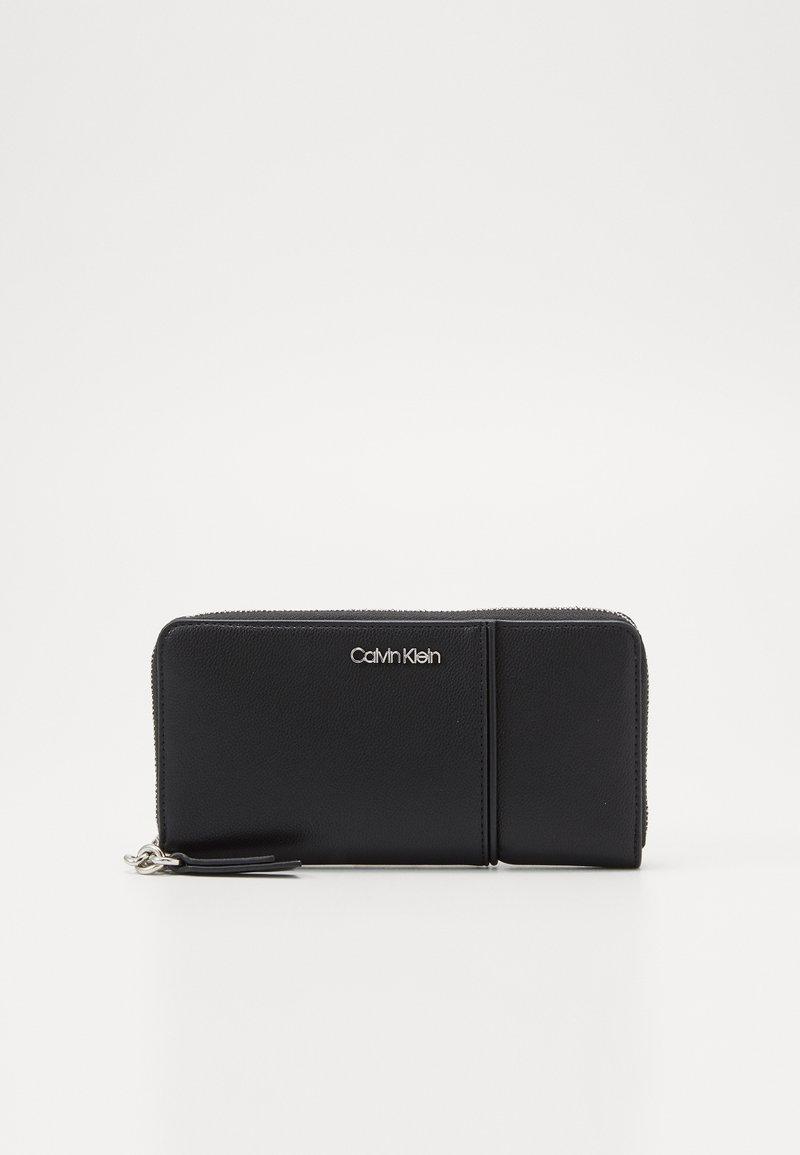 Calvin Klein - CHAIN ZIPAROUND - Wallet - black