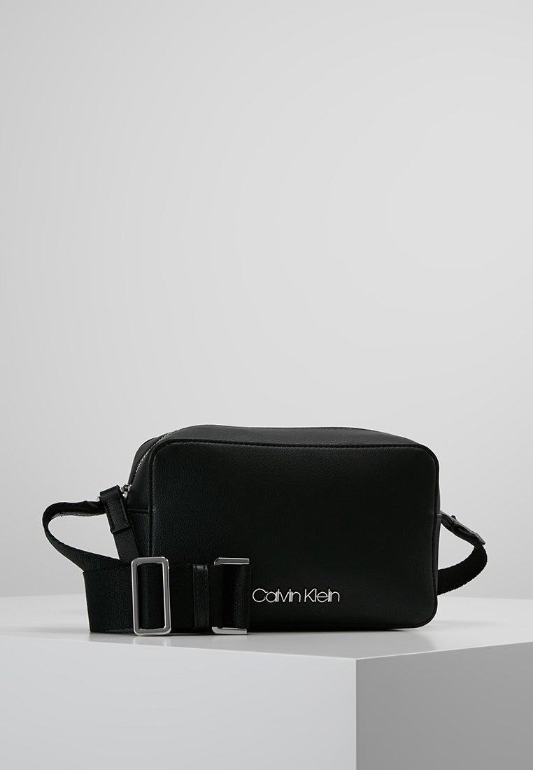 Calvin Klein - STRAP CAMERA BAG - Across body bag - black