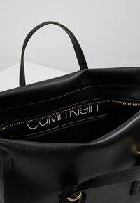 Calvin Klein - AVANT SMALL TOTE - Handbag - black - 4