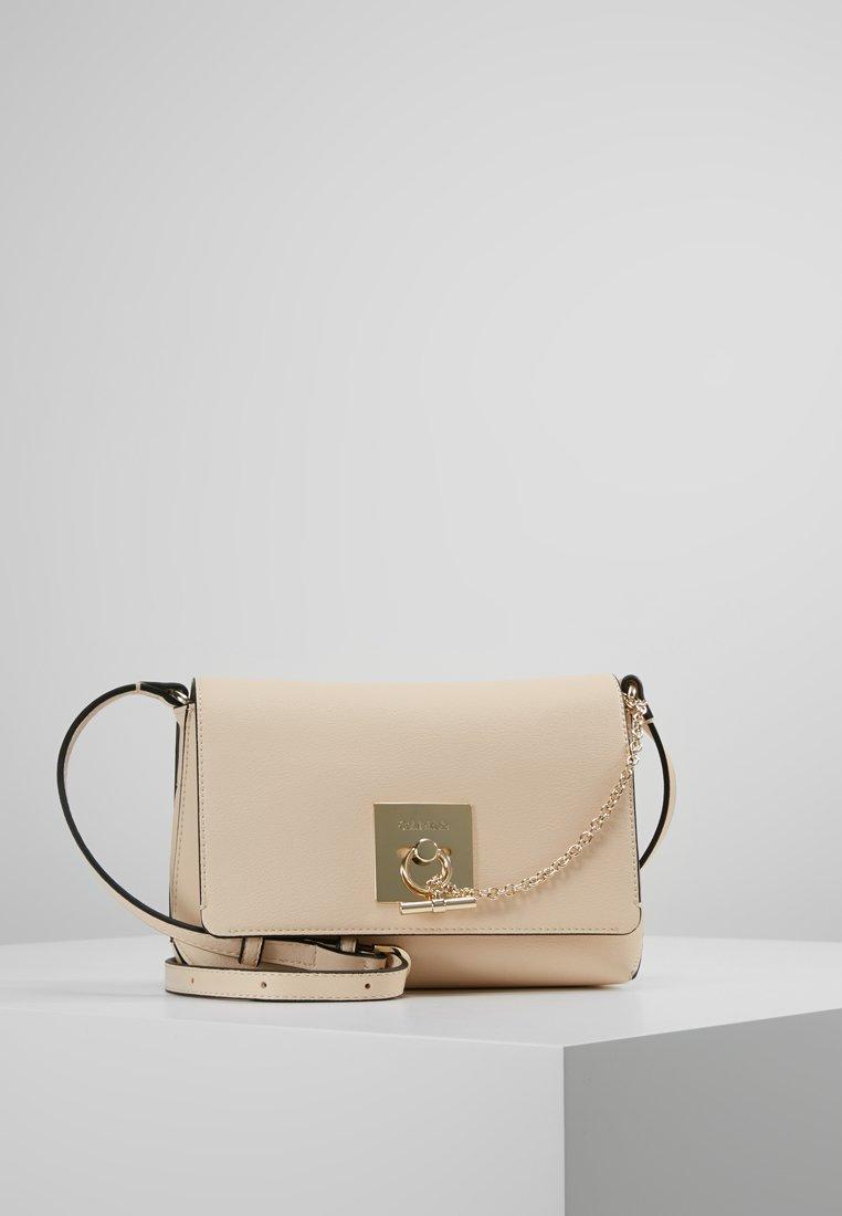 Calvin Klein - LOCK FLAP CROSSBODY - Across body bag - grey