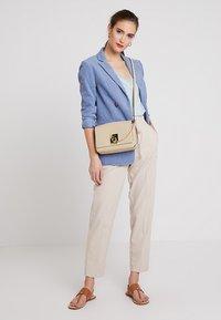 Calvin Klein - LOCK FLAP CROSSBODY - Across body bag - grey - 1