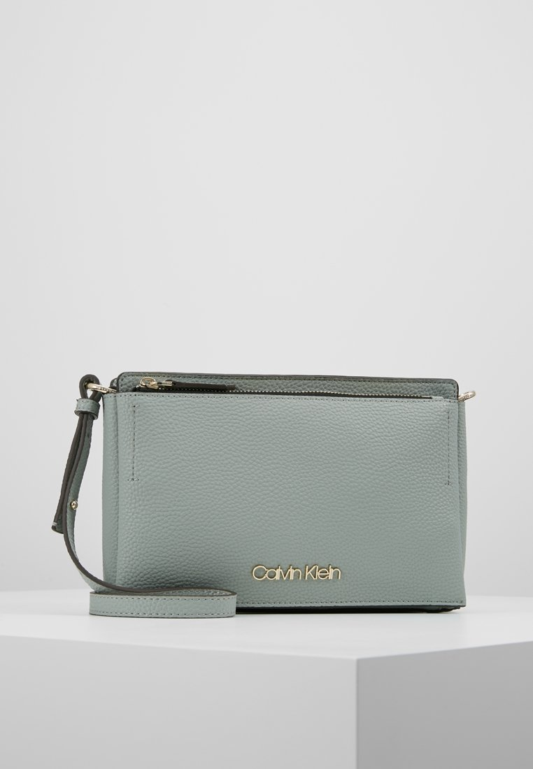 Calvin Klein - SIDED CROSSBODY - Sac bandoulière - grey