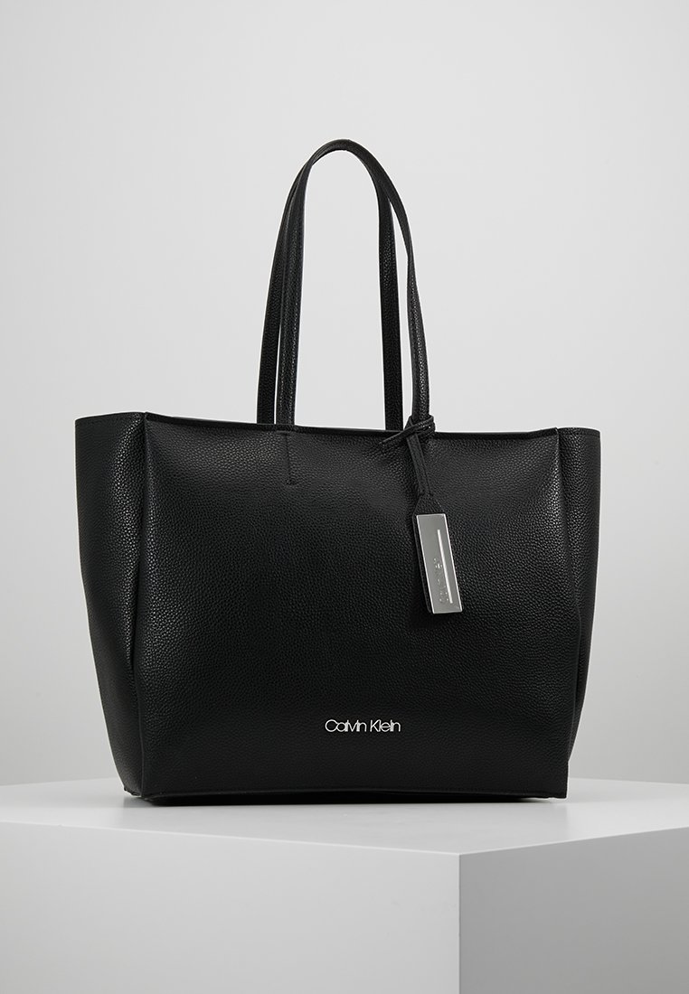 Calvin Klein - SIDED SHOPPER - Shopping bags - black