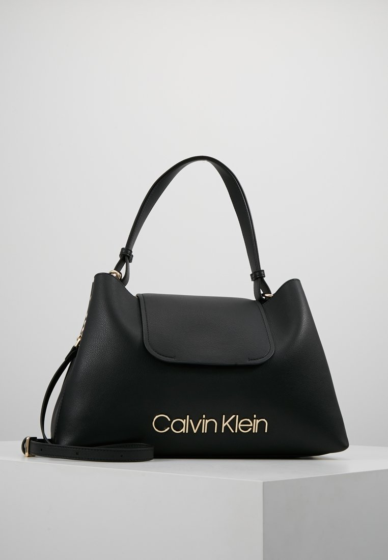 Calvin Klein - DRESSED UP TOP HANDLE - Bolso de mano - black