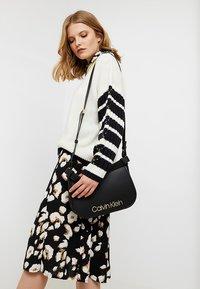 Calvin Klein - DRESSED UP SATCHEL - Håndveske - black - 1