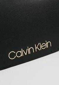 Calvin Klein - DRESSED UP SATCHEL - Håndveske - black - 6