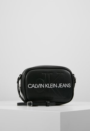 SCULPTED MONOGRAM CAMERA BAG - Sac bandoulière - black