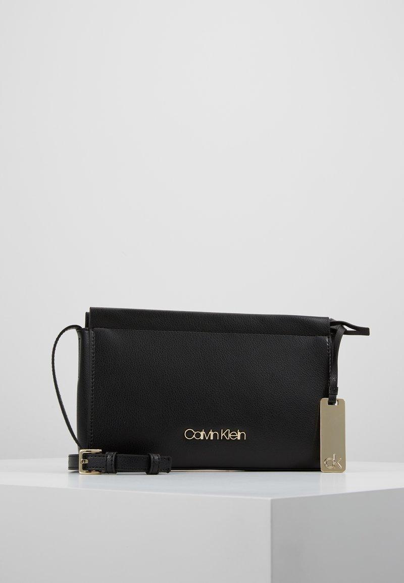 Calvin Klein - ENFOLD CROSSBODY - Umhängetasche - black