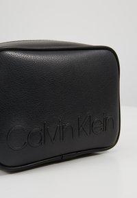 Calvin Klein - RAPID CAMERABAG - Skuldertasker - black - 6