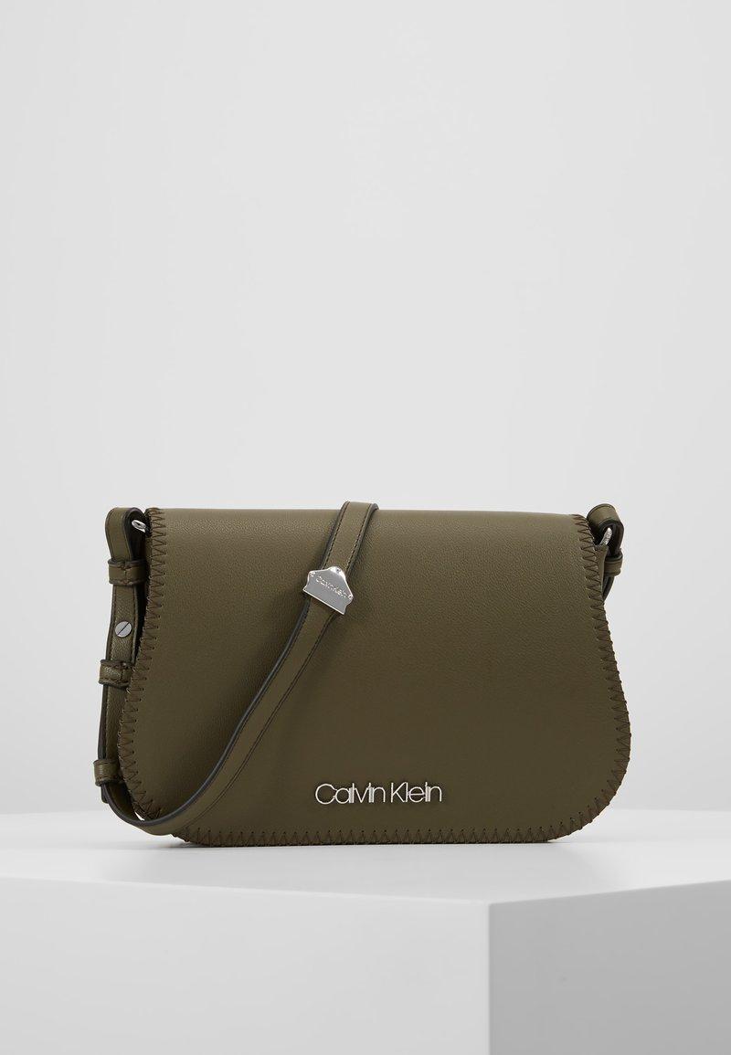 Calvin Klein - MELLOW SADDLE BAG - Across body bag - green