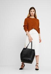 Calvin Klein - MELLOW TOTE - Handtasche - black - 1