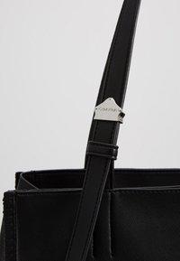Calvin Klein - MELLOW TOTE - Handtasche - black - 6