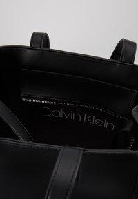 Calvin Klein - MELLOW TOTE - Handtasche - black - 4