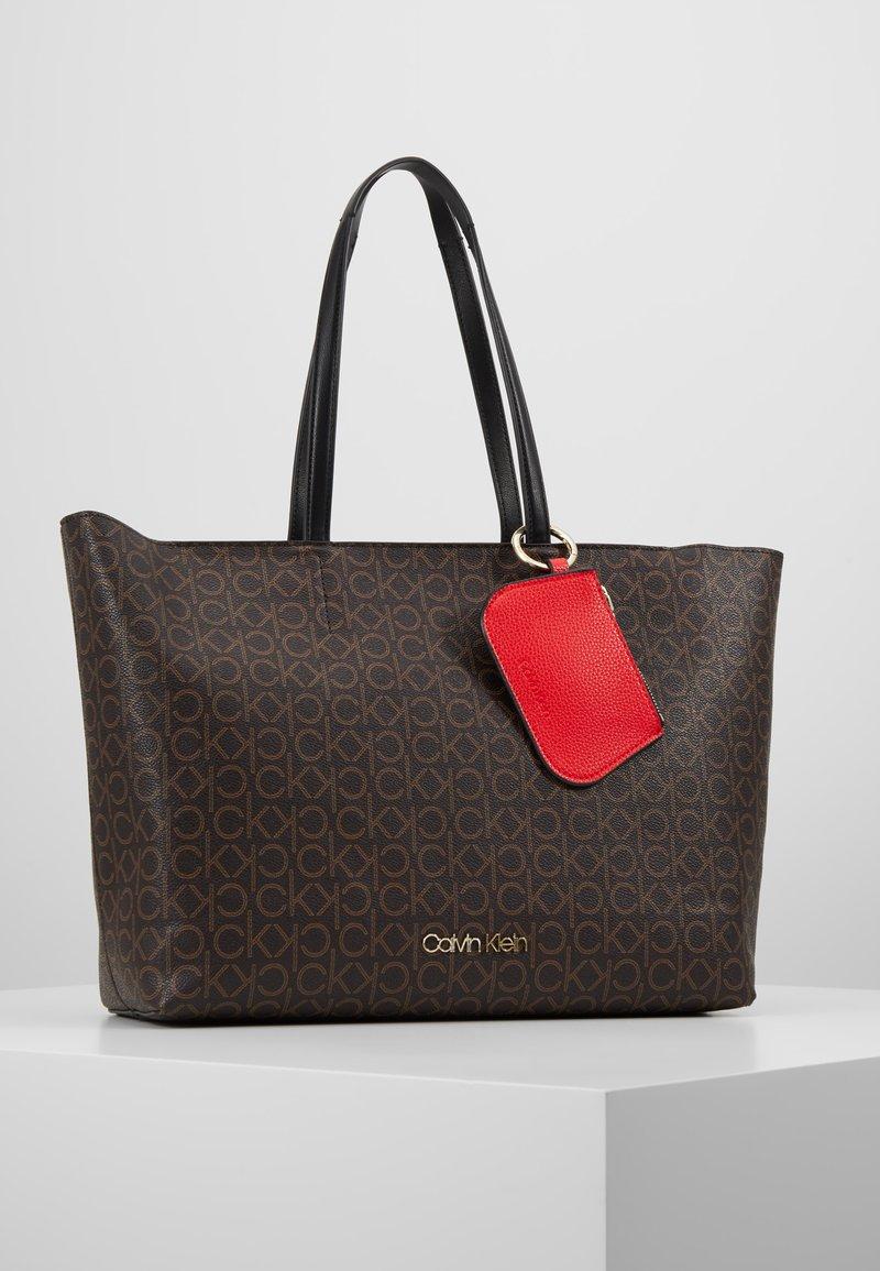Calvin Klein - MUST MONO - Tote bag - brown