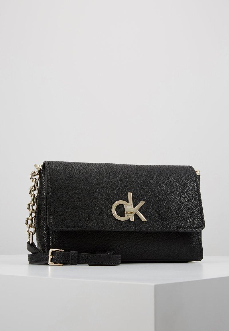 Calvin Klein - RE LOCK FLAP XBODY - Taška spříčným popruhem - black