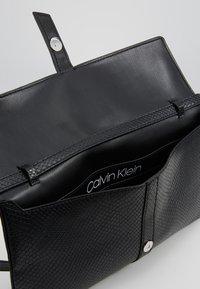 Calvin Klein - WINGED SHOULDER BAG - Handbag - black - 4