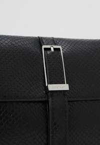 Calvin Klein - WINGED SHOULDER BAG - Handbag - black - 6