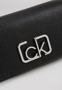 Calvin Klein - SIGNATURE FLAP XBODY - Umhängetasche - black - 6