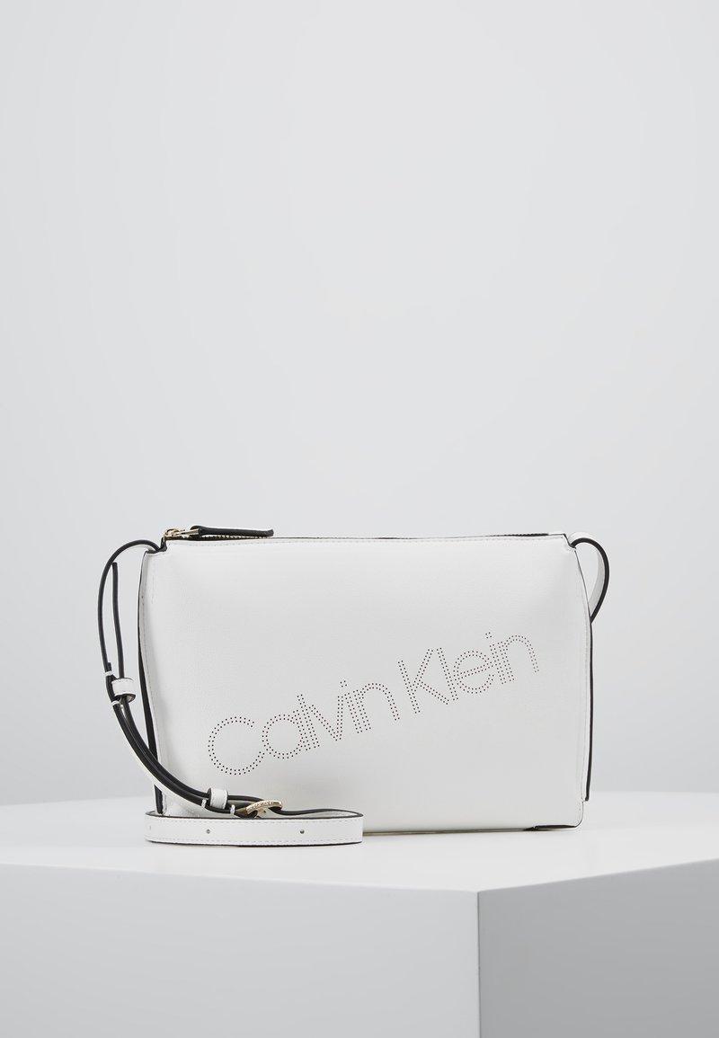 Calvin Klein - PUNCHED XBODY - Umhängetasche - white
