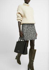 Calvin Klein - CK TASK TOTE - Handbag - black - 1