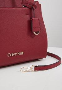 Calvin Klein - TASK TOTE - Torebka - red - 6