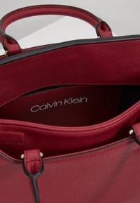 Calvin Klein - TASK TOTE - Torebka - red - 4