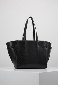 Calvin Klein - WINGED MED - Handbag - black - 2