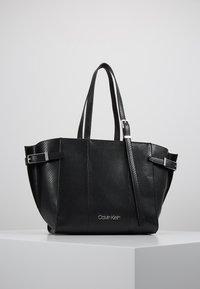 Calvin Klein - WINGED MED - Handbag - black - 0