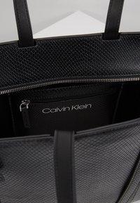 Calvin Klein - WINGED MED - Handbag - black - 4