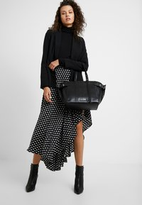 Calvin Klein - WINGED MED - Handbag - black - 1