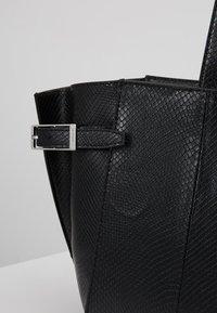 Calvin Klein - WINGED MED - Handbag - black - 6