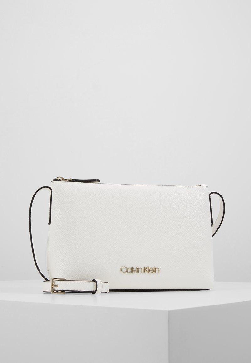 Calvin Klein - NEAT CROSSBODY - Torba na ramię - white