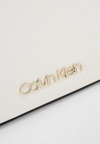Calvin Klein - NEAT CROSSBODY - Torba na ramię - white - 2