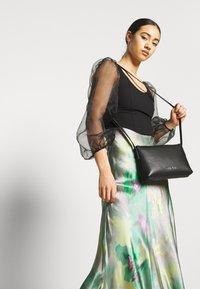 Calvin Klein - NEAT CROSSBODY - Torba na ramię - black - 1
