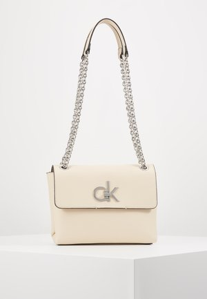 RE LOCK CROSSBODY - Schoudertas - pink