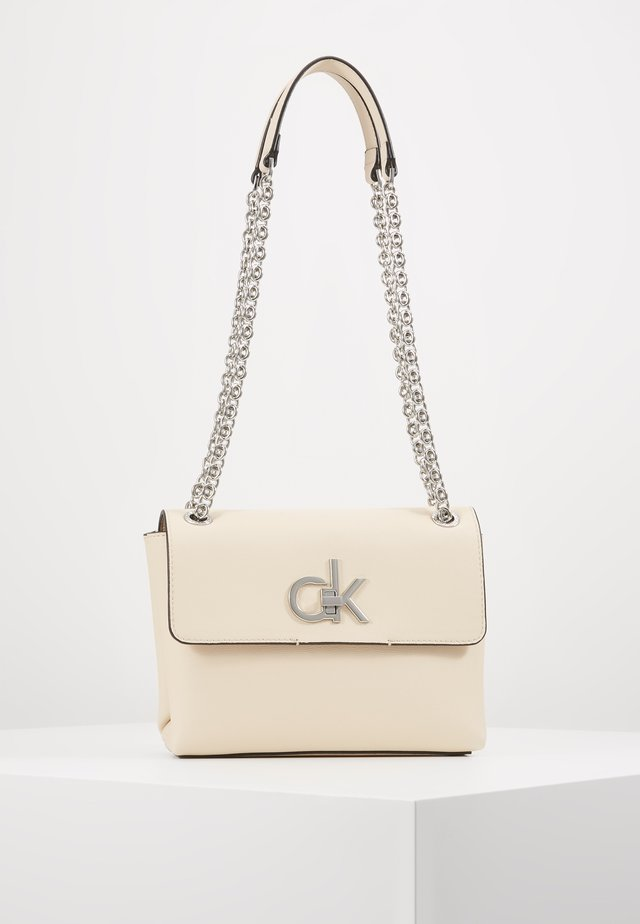 RE LOCK CROSSBODY - Sac bandoulière - pink