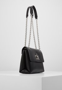 Calvin Klein - RE LOCK CROSSBODY - Across body bag - black