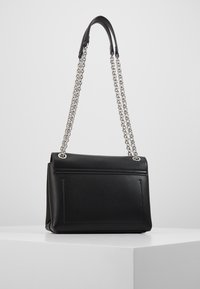Calvin Klein - RE LOCK CROSSBODY - Across body bag - black - 2