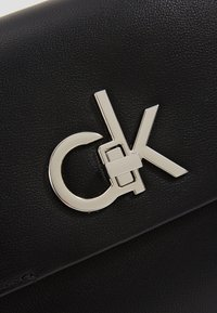 Calvin Klein - RE LOCK CROSSBODY - Across body bag - black - 6