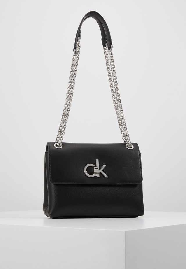RE LOCK CROSSBODY - Schoudertas - black