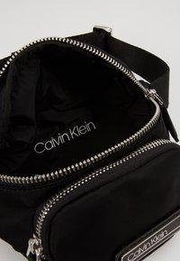 Calvin Klein - PRIMARY MINI WAISTBAG - Saszetka nerka - black - 4