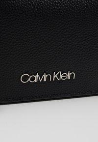 Calvin Klein - SIDED TRIO CROSSBODY - Axelremsväska - black - 2