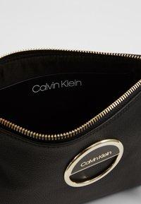 Calvin Klein - HOOP CROSSBODY - Schoudertas - black - 4