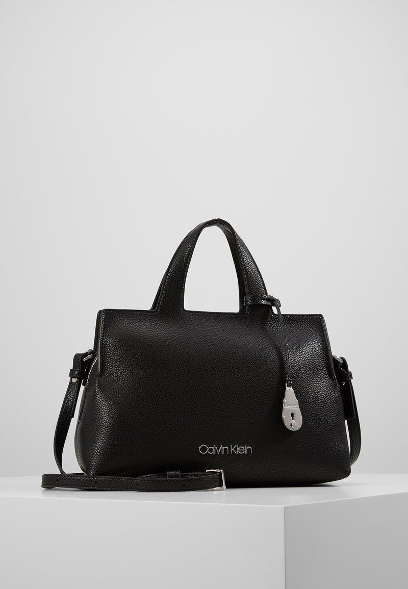 Calvin Klein - NEAT TOTE - Håndveske - black