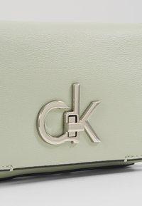 Calvin Klein - RE-LOCK FLAP CROSSBODY  - Skuldertasker - green - 2
