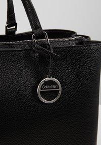Calvin Klein - SIDED TOTE - Håndveske - black - 5
