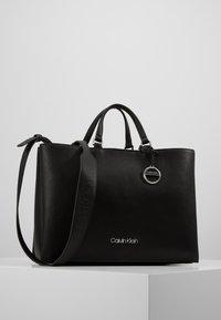 Calvin Klein - SIDED TOTE - Håndveske - black - 0